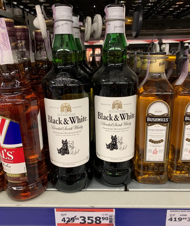 Виски Black&White по скидке в магазине Метро
